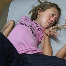Спинальная мышечная атрофия: что это, типы, симптомы и лечение